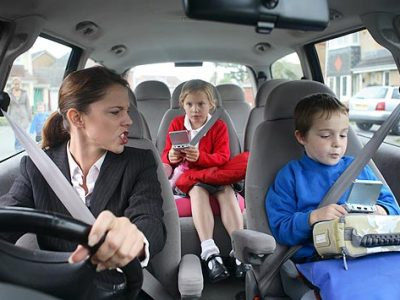 Mum taking kids to school in car